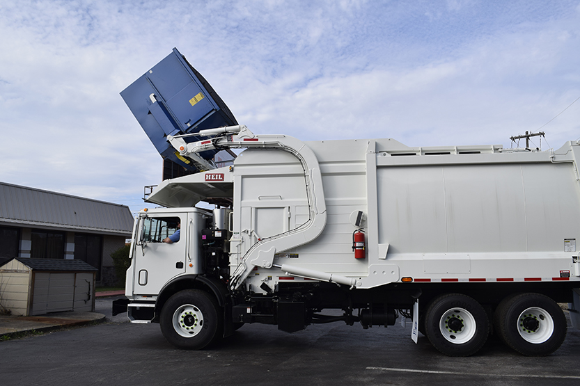 Half/Pack® Commercial Odyssey® Frontload Garbage Trucks