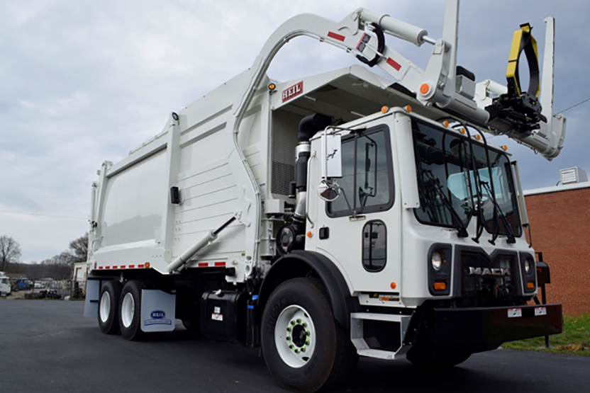 Half/Pack® Commercial Odyssey® Front Loader Garbage Trucks