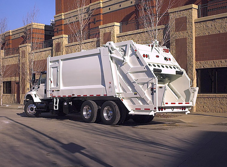 PowerTrak® Commercial Rear Load Garbage Truck