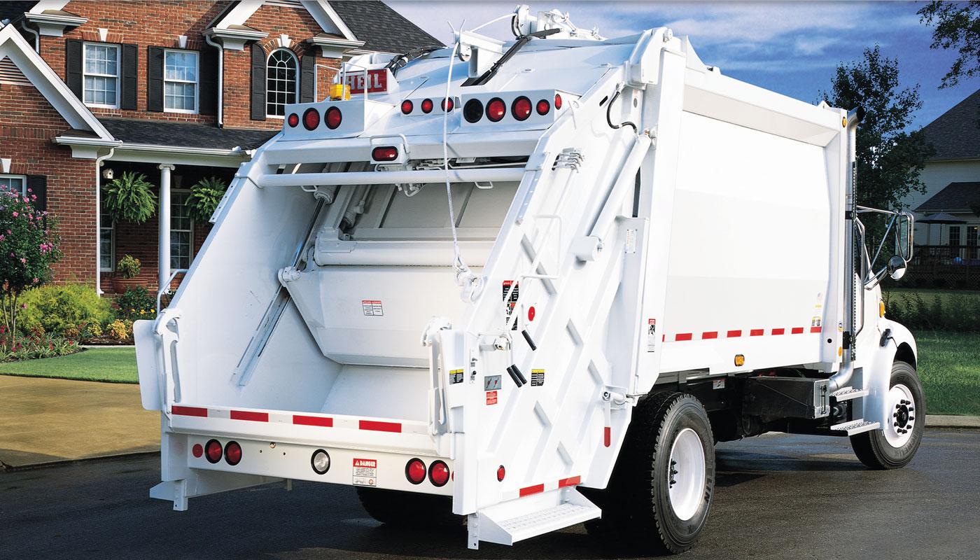 pt1000-rear-load-garbage-truck-hero.jpg