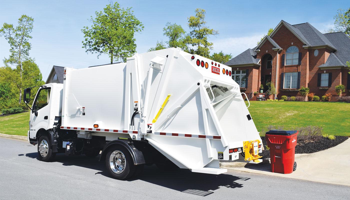 under-cdl-mini-rearload-garbage-truck.jpg